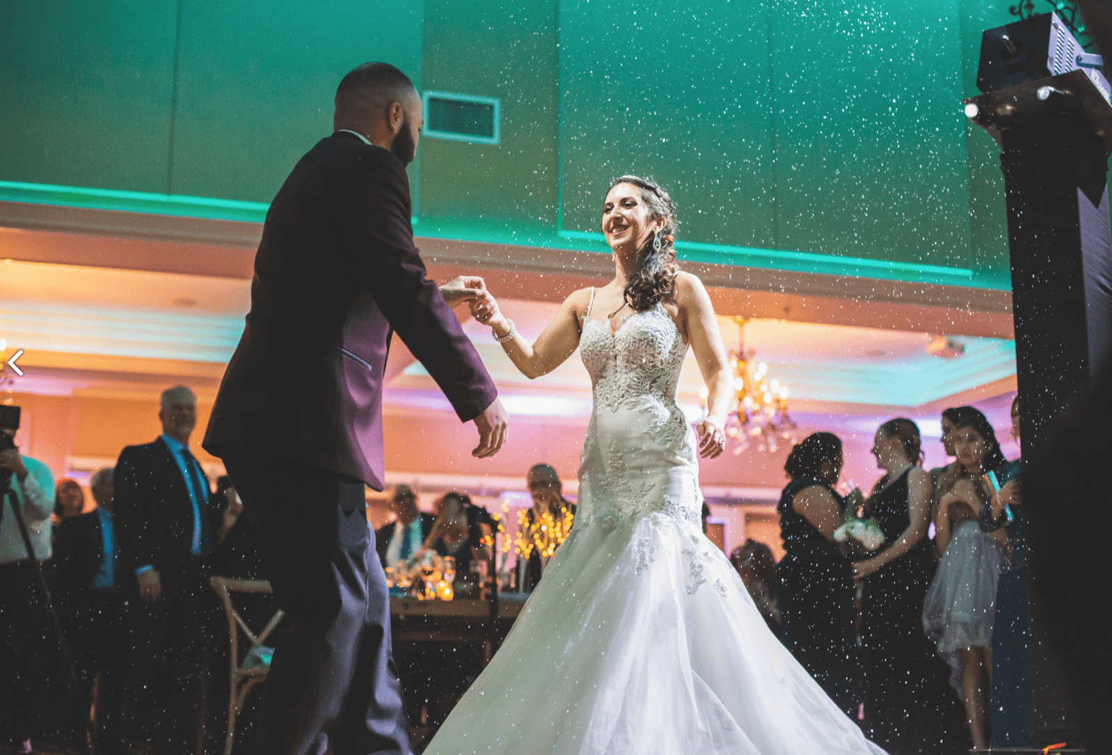 A bride and a groom dancing on the dance floor   Elegant Music Group - EMG
