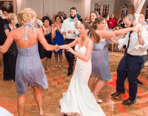 A bride and her family and friends dancing on the dance floor | Elegant Music Group - EMG