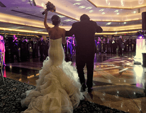 A bride and groom walking into their wedding reception | Elegant Music Group - EMG