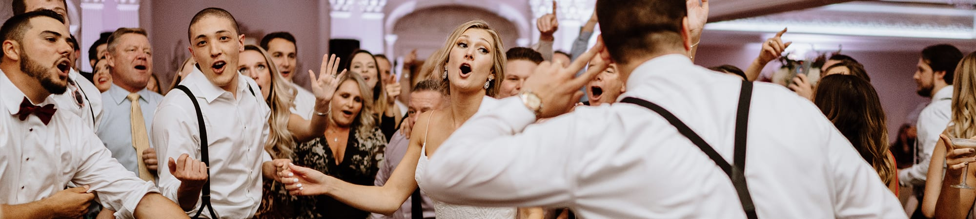 Woman dancing and singing at wedding | Elegant Music Group - EMG