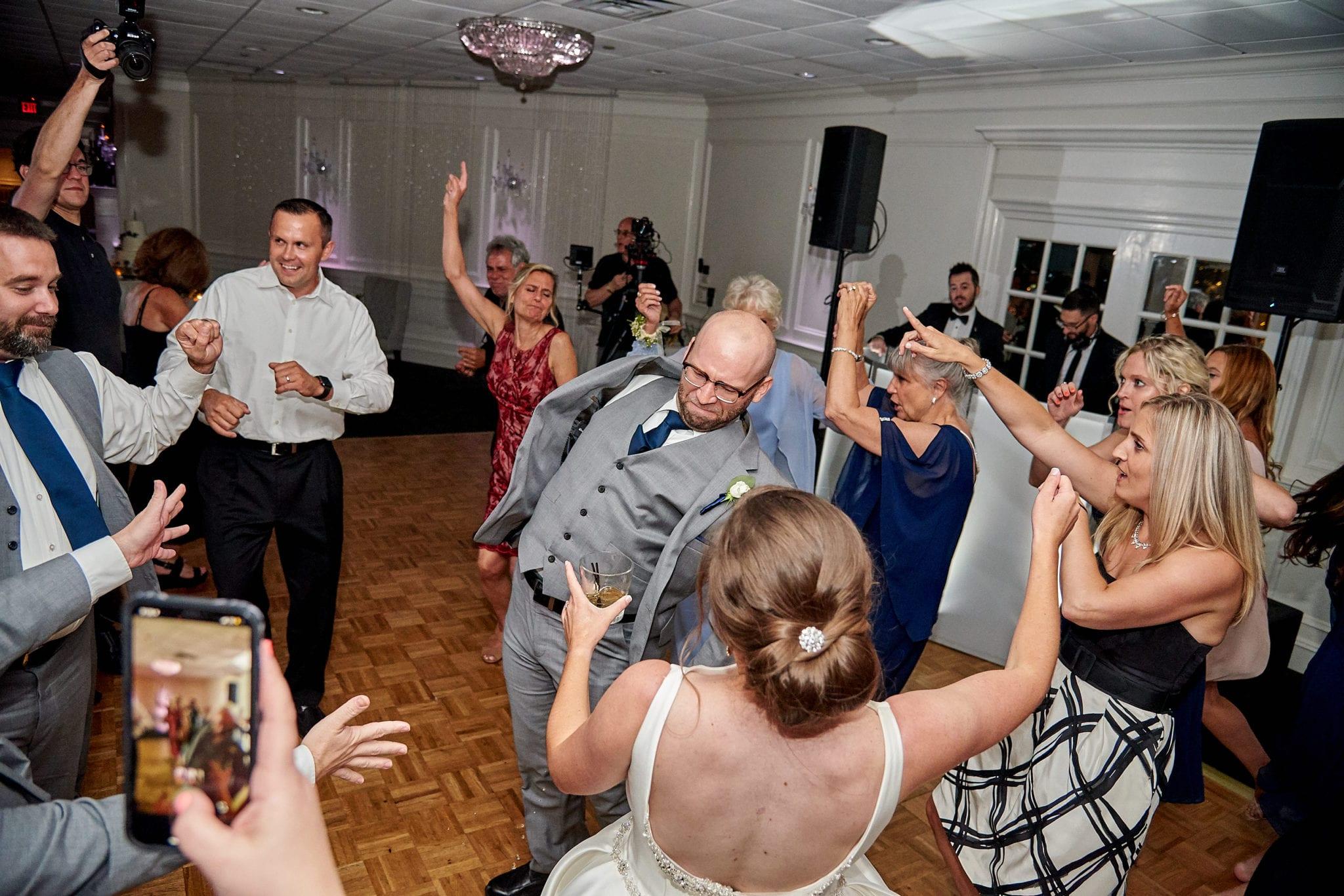 Wedding guests dancing at a reception.